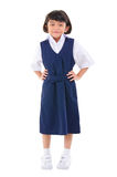 Southeast Asian school girl. Seven years old Southeast Asian school girl in school uniform, fullbody over white background Stock Photo