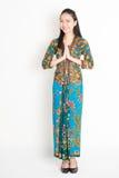 Southeast Asian woman in batik dress greeting Stock Photography