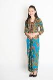 Southeast Asian woman in batik dress Royalty Free Stock Images