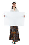 Southeast Asian woman holding a white blank card Royalty Free Stock Photography