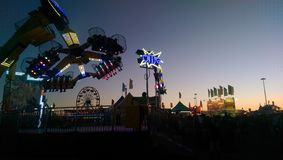The Southeast Texas State Fair. As dusk descends on the carnival rides and bright lights stock images