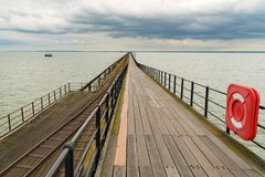 Southend-on-Sea, Essex, England, UK. May 30, 2017: View at Southend Pier longest pleasure pier in the world towards the Pier Head in the background Royalty Free Stock Photography