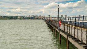 Southend-on-Sea, Essex, England, UK. May 30, 2017: View from Southend Pier longest pleasure pier in the world towards Southend, with some people walking and Royalty Free Stock Photography