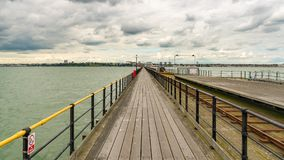 Southend-on-Sea, Essex, England, UK. May 30, 2017: View from Southend Pier longest pleasure pier in the world towards Southend, with some people walking Stock Photo