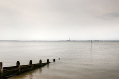 Southend on sea. Seascape of the essex coastline of southend on sea with a industrial sky line behind Stock Images