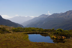 Southern Alps. Tiny lake on the very top of Key Summit in the heart of National Park Fiordland, Southern Island, New Zealand stock images