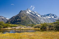 Southern Alps. Tiny lake on the very top of Key Summit in the heart of National Park Fiordland, Southern Island, New Zealand stock image