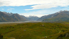 The Southern Alps and the Ashburton River. A landscape view of the Southern Alps near Methven in New Zealand Southern Island Royalty Free Stock Photo
