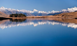 The Southern Alps Reflected in Lake Clearwater on a Sunny Day. Stock Images