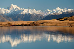 The Southern Alps Reflected in Lake Clearwater on a Sunny Day. Stock Photo