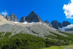 Southern Andes range Cerro Castillo in Chile. Southern Andes range rock towers in Chile. Trekking and hiling in Cerro Castillo snow capped peaks stock photo