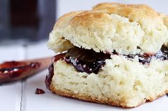 Southern Biscuit and Jelly. Buttermilk southern biscuit with raspberry or strawberry jam or jelly. Extreme shallow depth of field with selective focus on jam stock photo