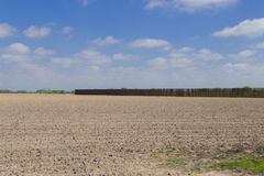 Southern border wall in Brownsville, Texas. Brownsville, TX - February 18, 2017: Border fence stretches on privately owned land, separating U.S. from Mexico. The Stock Photos