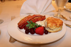 Southern breakfast fruit biscuit bacon. Breakfast fruit biscuit grits bacon Stock Photo