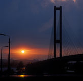 The Southern bridge against a sunset. Kyiv, Ukraine Royalty Free Stock Photography