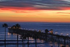 Southern California Pacific Ocean Pier. Colorful sunset over Pacific Ocean Southern California Pier royalty free stock image
