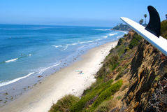 Southern California surfing beach with surfboard in the foregrou Royalty Free Stock Images