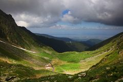 Summer mountain landscape in the Transylvanian Alps, with stormy clouds. The Southern Carpathians are a group of mountain ranges located in southern Romania To stock photo