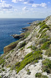 Southern coast of the Maltese islands. Coast in the Southern part of Malta in the limits of Ghar Lapsi Royalty Free Stock Photos