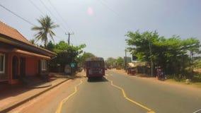 SOUTHERN COAST, SRI LANKA - FEBRUARY 2014: Timelapse of Sri Lankan traffic threw the windscreen of moving vehicle. stock video