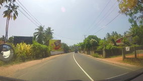 SOUTHERN COAST, SRI LANKA - FEBRUARY 2014: Vehicle overtaking motorcycle on the road in Sri Lanka. stock footage