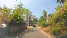 SOUTHERN COAST, SRI LANKA - FEBRUARY 2014: View of Sri Lankan countryside landscape from a moving vehicle. stock footage