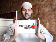 Southern company logo. Logo of energy and home services company southern company on samsung tablet holded by arab muslim man stock photography