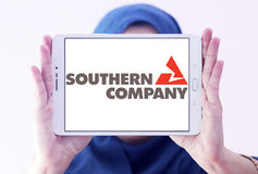 Southern company logo. Logo of energy and home services company southern company on samsung tablet holded by arab muslim woman royalty free stock photography