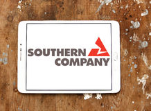 Southern company logo. Logo of energy and home services company southern company on samsung tablet on wooden background royalty free stock image