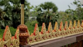 In southern country there is a view of fence with a triangular pattern at top. On sights of Thailand beautiful decoration is made, which attracts tourists and stock video footage