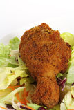 Southern fried chicken on salad plate Royalty Free Stock Images