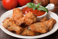 Southern fried chicken wings. With barbecue sauce Royalty Free Stock Photos
