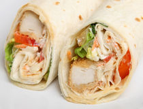 Southern Fried Chicken Wrap Sandwich. Selective focus on RH wrap Royalty Free Stock Photo