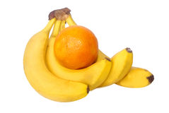 Southern fruits. Fruit of bananas and orange on a white background Royalty Free Stock Images