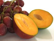 Mango and grapes, summer and sun. stock images