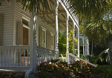 Southern grace. Lovely southern frame house with veranda and tropical foliage, Key West, Florida royalty free stock images