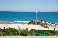 Southern Groyne. Southern rocky groyne with patrol tower and an Indian Ocean seascape at City Beach with dune replanting in Western Australia Royalty Free Stock Photos