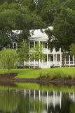 Southern home. Traditional southern home with reflection on water stock photography