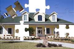 Southern Home Puzzle. An Amercan residential home in the south with puzzle pieces missing Royalty Free Stock Photo