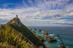 View of Nugget point lighthouse near Kaka point. Southern island of New Zealand stock photo
