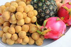 Southern langsat and Dragon fruit close up on plate Stock Image