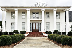 Southern Mansion. With large white columns in winter Royalty Free Stock Image