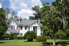 Southern Mansion. With Oaks and Spanish Moss Stock Image