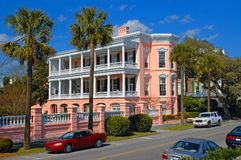 Southern Mansion with palms. Beautiful pink mansion in downtown Charleston, South Carolina's historic section Stock Photo