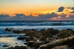 SOUTHERN OCEAN SUNRISE WAVES HITTING ROCKS royalty free stock photos