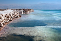 Dead Sea salt. The southern part of the Israeli shore Dead Sea. In the background mountains of Jordan Royalty Free Stock Image