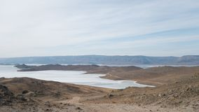 The southern part of Olkhon island. Desert steppe area and small Bay of lake Baikal.  stock photo