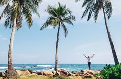 Southern point Sri Lanka island - Dondra cape, woman stands on c. Oast and looks on horizont line royalty free stock photography