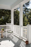A Southern Porch. A porch nestled into the live oaks makes an inviting spot to rest Stock Photography