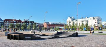Southern port in Luleå. On the south beach there is a kiosk, sandy beach, seating furniture and umbrella, barbecue areas, concrete ping pong table, volleyball royalty free stock photo
